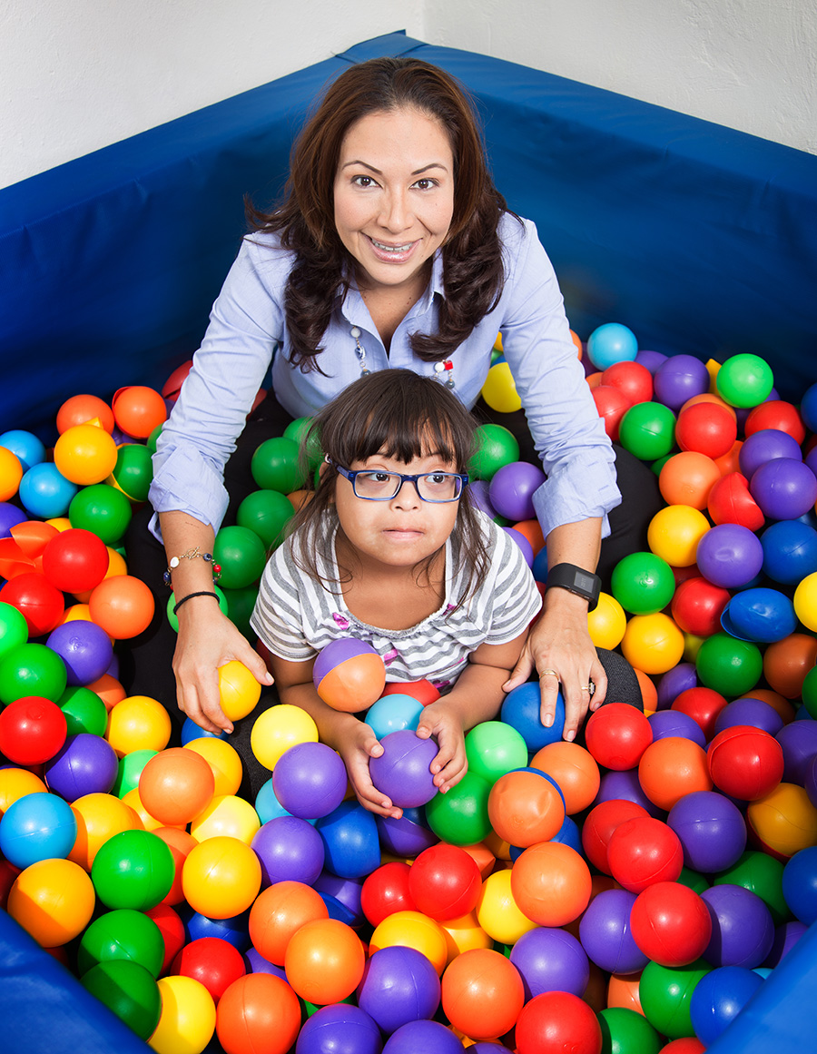 Sofia Figueroa-Leon in the ball pit with a patient at the Caribbean Kids and Families Therapy Organization's therapy centre. Make-up by Shenelle Escayg, photography by Mark Lyndersay.